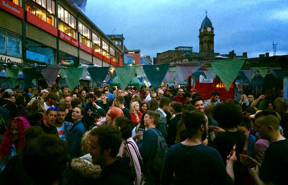 A buzzing Exchange Street during the 2018 festival