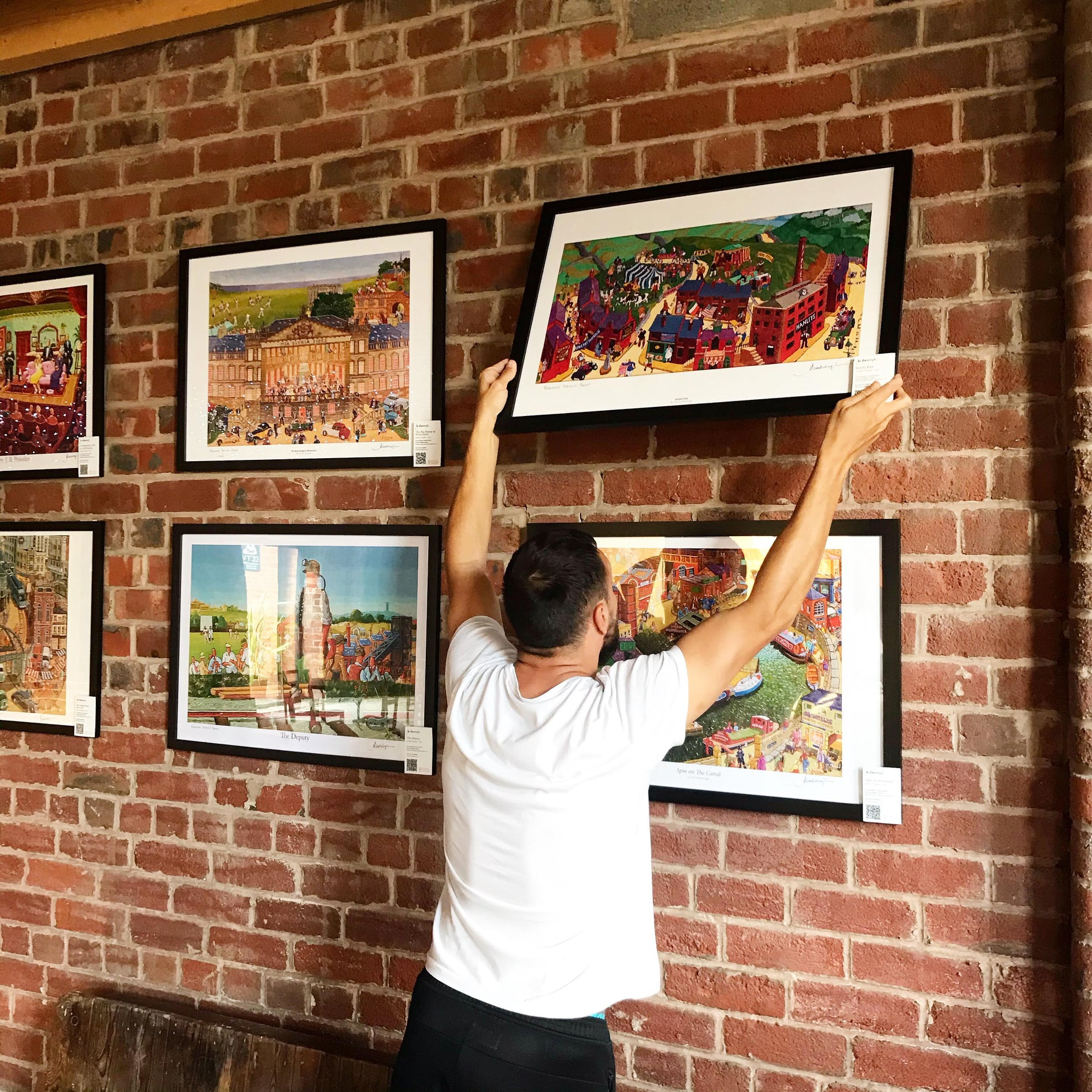 Joe Scarborough's work being hung in Dyson Place