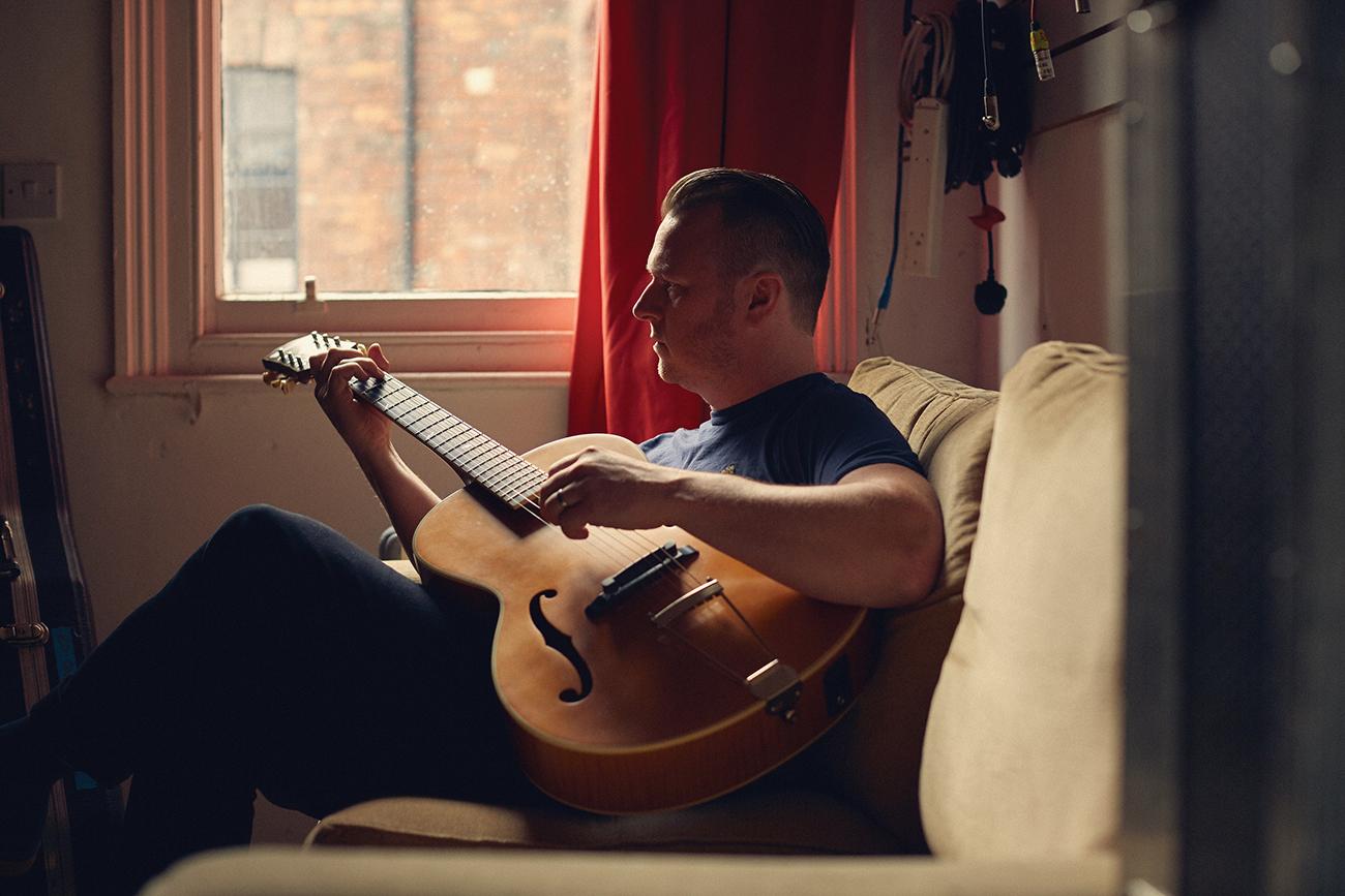 Ed Cousens, relaxing with his guitar
