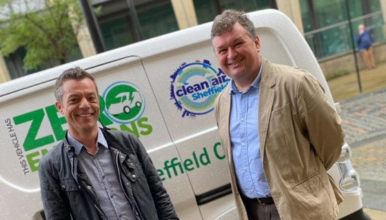 Councillors Robert Johnson (left) and Mark Jones (right) in front of an electric vehicle festooned with Clean Air Sheffeld branding
